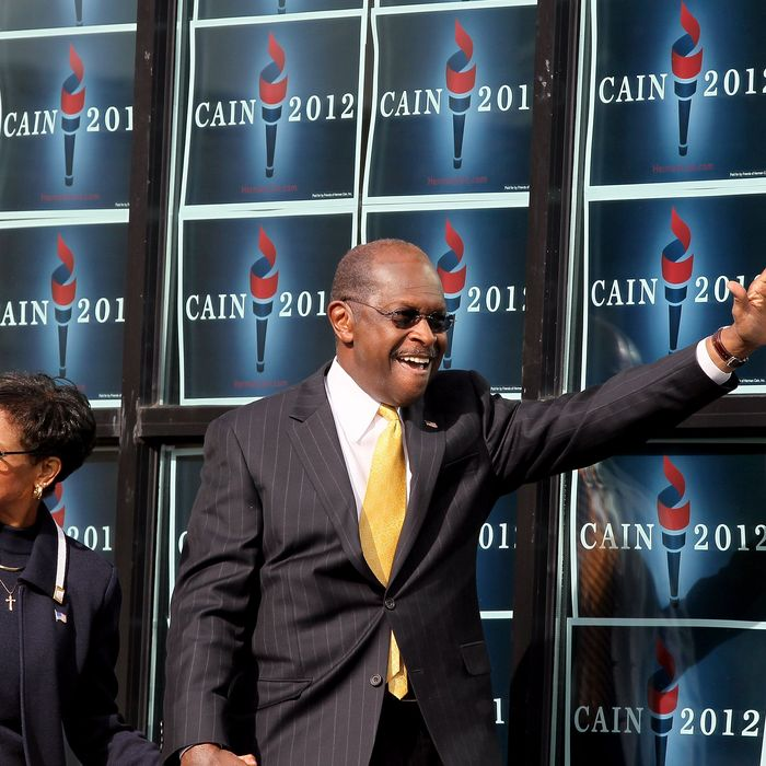 ATLANTA, GA - DECEMBER 03: Republican presidential candidate Herman Cain and his wife Gloria Cain arrives to speak during the scheduled opening of a local campaign headquarters on December 3, 2011 in Atlanta, Georgia. Cain took time to reassess the condition of his campaign