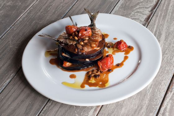 Sardines and eggplant with roasted tomato, pine nuts, currants, and lamb jus.