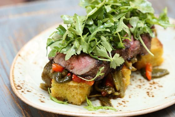 Steak bavette with cornbread panzanella and roasted and pickled poblanos.