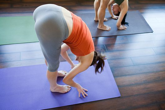 Two women doing yoga class --- Image by ? Image Source/Corbis