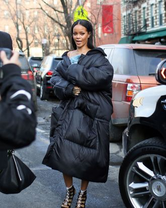 Rihanna wears a coat.
