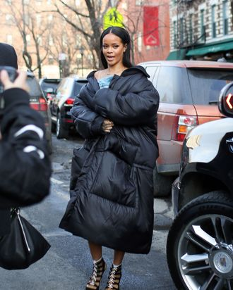 Rihanna wears a coat.