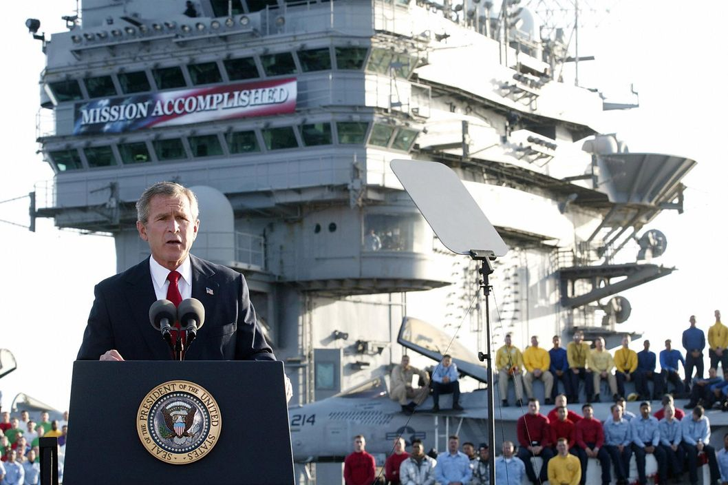"US President George W. Bush addresses the nation aboard the nuclear aircraft carrier USS Abraham Lincoln 01 May, 2003, as it sails for Naval Air Station North Island, San Diego, California. Bush declared major fighting over in Iraq, calling it ""one victory in a war on terror"" which he said would continue until terrorists are defeated. ""In the Battle of Iraq, the United States and our allies have prevailed,"" Bush said. Bush touted Saddam Hussein's ouster as ""a crucial advance"" towards stamping out extremist violence.AFP Photo/Stephen JAFFE"