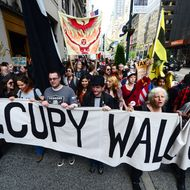 Occupy Wall Street participants march down Fifth Avenue as part of May Day events in New York, May 01, 2012. The Occupy movement that shook the United States last year, spawning similar protests worldwide, announced widespread May Day demonstrations and strikes against social inequality Tuesday. The protests, billed as stretching from New York to California, and from Spain to Australia, raised the possibility of disruption in dozens of urban centers on the date when many countries observe International Workers' Day.  AFP PHOTO/Emmanuel Dunand        (Photo credit should read EMMANUEL DUNAND/AFP/GettyImages)