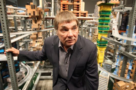 12 Jan 2012, Los Angeles, California, USA --- Chris Burden stands next to his large-scale kinetic sculpture, Metropolis II, during the media preview at the Los Angeles County Museum of Art (LACMA) in Los Angeles, California January 11, 2012. The sculpture, modeled after a fast-paced futuristic city with 1,100 miniature cars running through an elaborate system of roadway tracks at a scale speed of about 240 miles per hour (386 kph), is meant to evoke the energy of a city. The exhibit opens to the public January 14. REUTERS/David McNew (UNITED STATES - Tags: TRANSPORT SOCIETY) --- Image by ? DAVID MCNEW/Reuters/Corbis