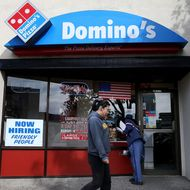 Domino's Sued Again for Allegedly Paying Workers Less Than Minimum Wage
