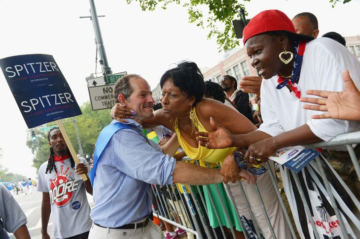 Comptroller candidate Eliot Spitzer campaigns at the West Indian Day Parade on September 2, 2013 in the Brooklyn borough of New York City. Over a million people are expected to attend the 46th annual parade.