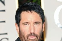 Composer Trent Reznor arrives at the 69th Annual Golden Globe Awards held at the Beverly Hilton Hotel on January 15, 2012 in Beverly Hills, California.