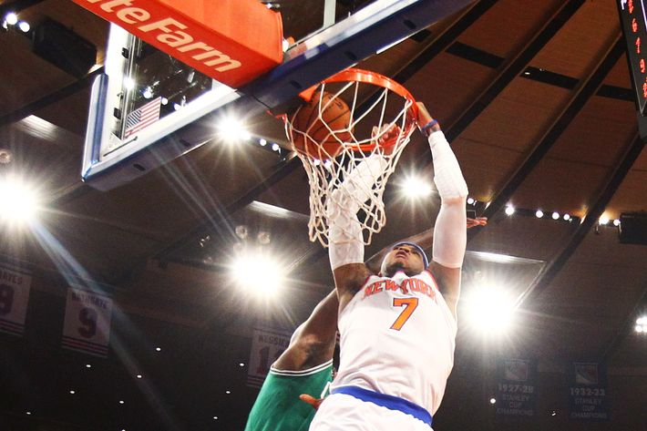 NEW YORK, NY - MAY 01:  Carmelo Anthony #7 of the New York Knicks dunks the ball against the Boston Celtics during Game five of the Eastern Conference Quarterfinals of the 2013 NBA Playoffs at Madison Square Garden on May 1, 2013 in New York City.  NOTE TO USER: User expressly acknowledges and agrees that, by downloading and or using this photograph, User is consenting to the terms and conditions of the Getty Images License Agreement.  (Photo by Al Bello/Getty Images)