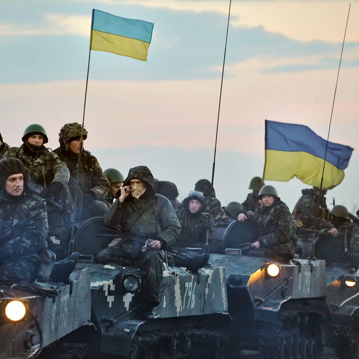 Ukrainian troops ride tanks on the way toward Slovyanks on April 14, 2014 in Ukraine. Tension has been rising in Ukraine, with pro-Russian activists occupying buildings in more eastern towns and a Russian fighter jet making passes over a U.S. warship in the Black Sea.