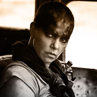 MAD MAX: FURY ROAD - 2015 FILM STILL - CHARLIZE THERON as Furiosa - Photo Credit: Jasin Boland © 2015 WV FILMS IV LLC AND RATPAC-DUNE ENTERTAINMENT LLC - U.S., CANADA, BAHAMAS & BERMUDA © 2015 VILLAGE ROADSHOW FILMS (BVI) LIMITED - ALL OTHER TERRITORIES