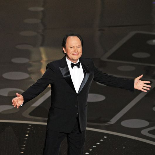 Comedian Billy Crystal arrives on stage to present an award at the 83rd Annual Academy Awards held at the Kodak Theatre on February 27, 2011 in Hollywood, California. AFP PHOTO / GABRIEL BOUYS (Photo credit should read GABRIEL BOUYS/AFP/Getty Images)