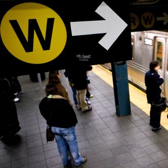 Passengers wait on the