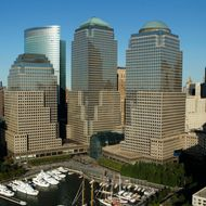 The headquarters of The Goldman Sachs Group Inc. stands behind the World Financial Center in this aerial photograph taken over New York, U.S., on Saturday, Oct. 2, 2010. New York City sold $775 million in Build America Bonds as international buyers purchased about 16 percent of the debt, the most in the city's history.