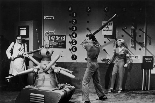 From left to right, Herbert Marshall (1890 - 1966), Richard Egan (1921 - 1987) and Constance Dowling (1920 - 1969) battle a killer robot in a still from the science fiction film 'Gog', 1954. (Photo by Archive Photos/Getty Images)