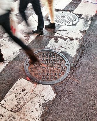 USA, New York City, Manhattan, Times Square, People stepping on manhole cover