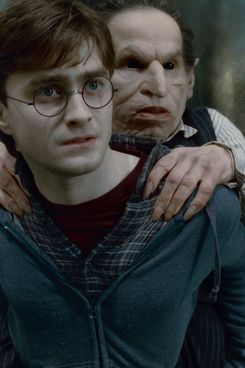 """(L-r) DANIEL RADCLIFFE as Harry Potter and WARWICK DAVIS as Griphook in Warner Bros. Pictures' fantasy adventure """"HARRY POTTER AND THE DEATHLY HALLOWS – PART 2,"""" a Warner Bros. Pictures release."""