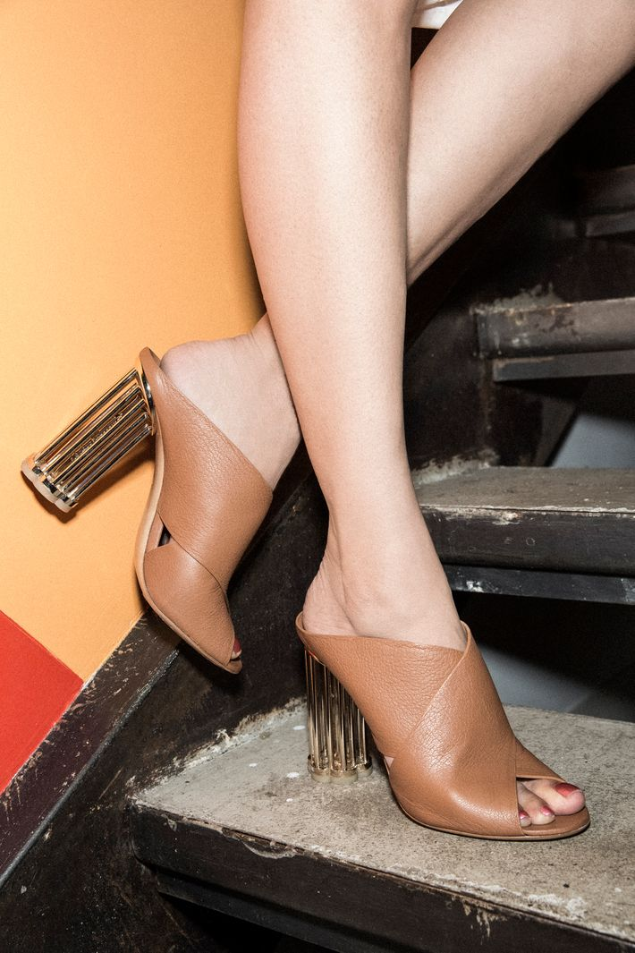 Anu Duggal wears Salvatore Ferragamo sandals.