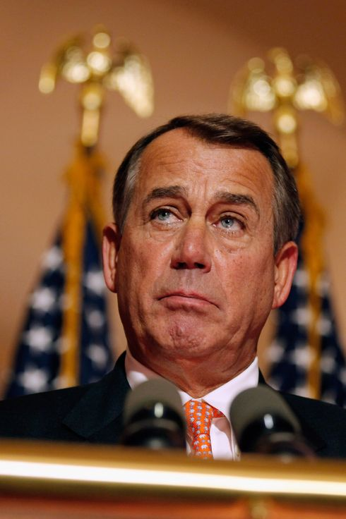 Speaker of the House U.S. Rep. John Boehner (R-OH) answers reporters' questions during a brief news conference on the payroll tax vote outside his office at the U.S. Capitol December 19, 2011 in Washington, DC.