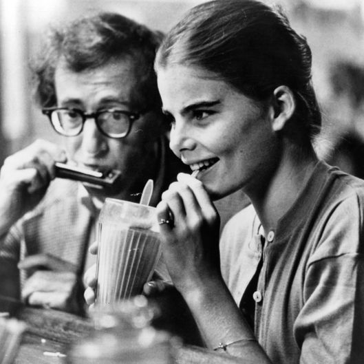 Woody Allen plays harmonica to Mariel Hemingway in a scene from the film 'Manhattan' 1979. (Photo by United Artists/Getty Images)