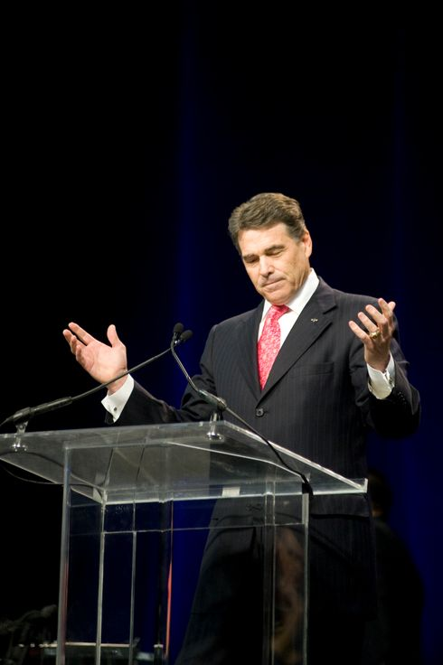 "HOUSTON, TX -  AUGUST 6:   Texas Governor Rick Perry speaks to an estimated 30,000 attendees at the non-denominational prayer and fasting event, ""The Response,"" on August 6, 2011 in Houston, Texas. Thousands attended the event organized by Gov. Rick Perry in order to pray for God to help save ""a nation in crisis"" referring to America.  (Photo by Brandon Thibodeaux/Getty Images)"