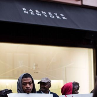 Rashawn Moose Cheatham (L) protests outside Barneys flagship store, accusing the store of racial profiling, on October 30, 2013 in New York City. On April 29, 2013 Trayon Christian, 19, was detained and then arrested by undercover police after buying a $349 belt at Barneys.