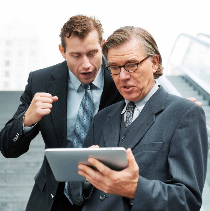 Businessmen looking at digital tablet