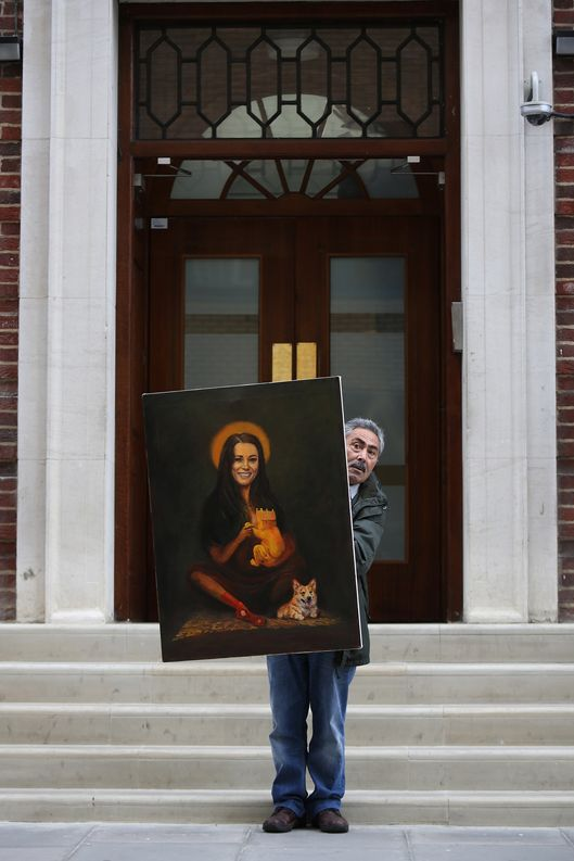 Artist Kaya Mar stands with his latest painting entitled 'Kate Middleton' outside the The Lindo Wing of St Mary's Hospital as the UK prepares for the birth of the first child of The Duke and Duchess of Cambridge at St Mary's Hospital on July 2, 2013 in London, England.