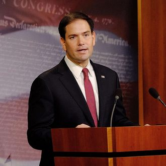 Sen. Marco Rubio (R-FL) reacts to U.S. President Barack Obama's announcement about revising policies on U.S.-Cuba relations on December 17, 2014 in Washington, DC. Rubio called the President a bad negotiator and criticized what he claimed was a deal with no democratic advances for Cuba.