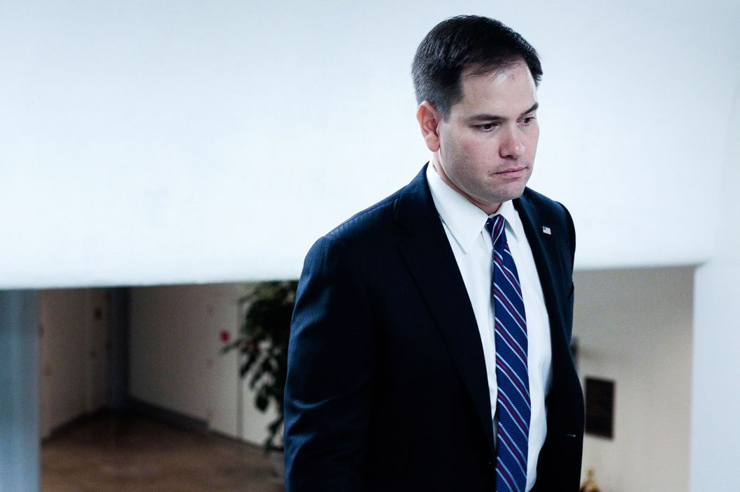 U.S. Sen. Marco Rubio (R-FL) heads to the weekly Senate Republicans policy luncheon on March 19, 2013 in Washington, DC. The Senate is expected to pass a revised continuing resolution and send their edits back to the House in order to prevent a government shutdown next week, but any action in the Senate may be delayed until later in the week.