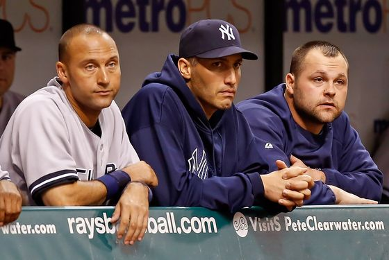 ST. PETERSBURG - SEPTEMBER 04:  Infielder Derek Jeter #2 (left), pitcher Andy Pettitte #46 and pitcher Joba Chamberlain #62 of the New York Yankees watch the end of the game against the Tampa Bay Rays at Tropicana Field on September 4, 2012 in St. Petersburg, Florida.  (Photo by J. Meric/Getty Images)