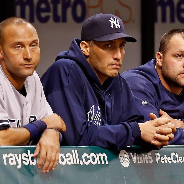 Infielder Derek Jeter #2 (left), pitcher Andy Pettitte #46 and pitcher Joba Chamberlain #62 of the New York Yankees watch the end of the game against the Tampa Bay Rays at Tropicana Field on September 4, 2012 in St. Petersburg, Florida.