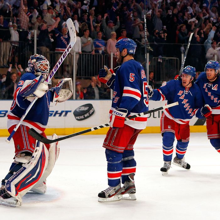 NEW YORK, NY - MAY 12: (L-R) Goalie Henrik Lundqvist #30, Dan Girardi #5, Ryan McDonagh #27 and Brad Richards #19 of the New York Rangers celebrate after they won 2-1 against the Washington Capitals in Game Seven of the Eastern Conference Semifinals during the 2012 NHL Stanley Cup Playoffs at Madison Square Garden on May 12, 2012 in New York City. (Photo by Paul Bereswill/Getty Images)