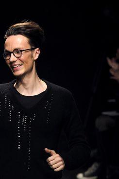 Maxime Simoens is not waving goodbye to Leonard or waving hello to Christian Dior. He's just waving.