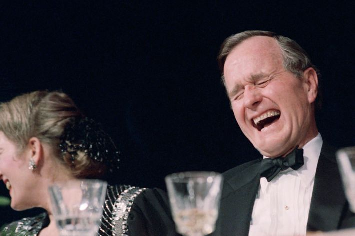 U.S. President George H. Bush laughs historically during comedian Jim Morris' performance at the White House Correspondents annual dinner in Washington, Saturday night, April 29, 1989. (AP Photo/J. Scott Applewhite)