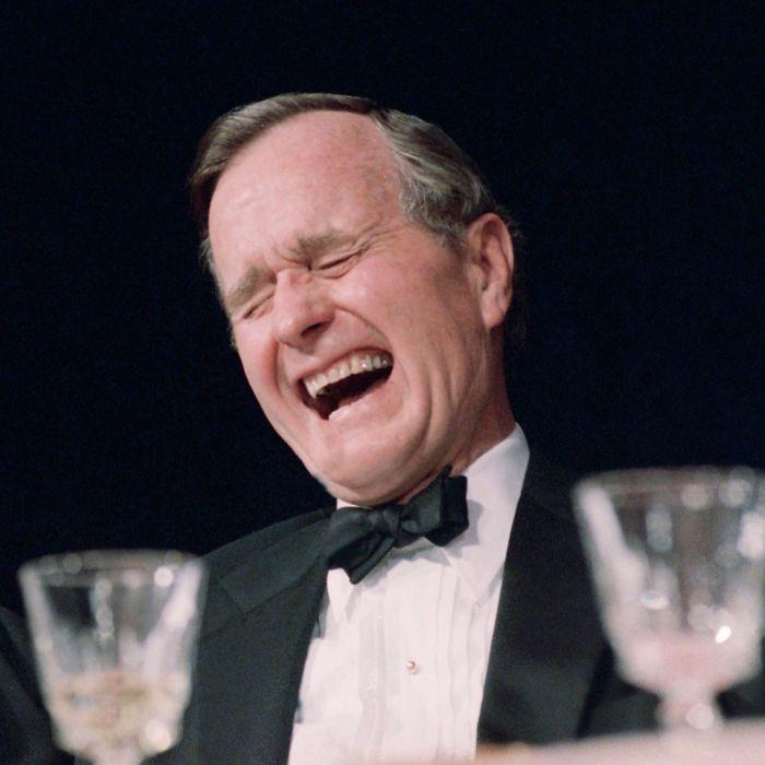 U.S. President George H. Bush laughs historically during comedian Jim Morris' performance at the White House Correspondents annual dinner in Washington, Saturday night, April 29, 1989. (AP Photo/J. Scott Applewhite)
