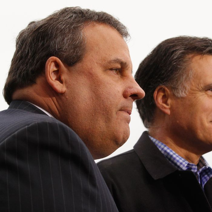 Former Massachusetts Governor and Republican presidential candidate Mitt Romney (R) and New Jersey Governor Chris Christie are interviewed on television after a campaign rally at a Hy Vee supermarket December 30, 2011 in West Des Moines, Iowa. Christie, a popular Republican governor who was urged to run for president earlier this year, appeared with Romney just days before the