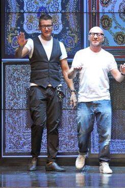 Designers Stefano Gabbana (L) and Domenico Dolce acknowledge the audience at the end of the D&G Spring-Summer 2012 Menswear collection on June 20, 2011 during the Men's fashion week in Milan.  AFP PHOTO / GIUSEPPE CACACE (Photo credit should read GIUSEPPE CACACE/AFP/Getty Images)