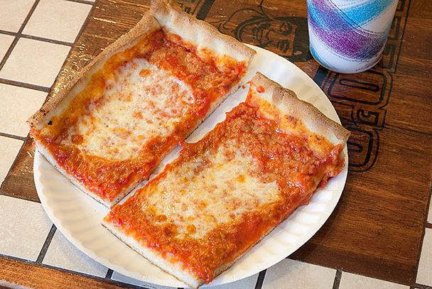 "<b>Sicilian Slice</b>    <a href=""http://rizzosfinepizza.com/"">Rizzo's Fine Pizza</a>    <i>Queens, New York</i>  While most Sicilian slices are marked by the conquest of sluggish starch under a splatter of sauce and cheese, Astoria's 54-year-old Sicilian specialist dominates its hearty-crusted rectangles with a thick deluge of the good stuff; herb-saturated sauce and a single sheet of mozzarella encapsulated in a crackly, paper-thin parapet."