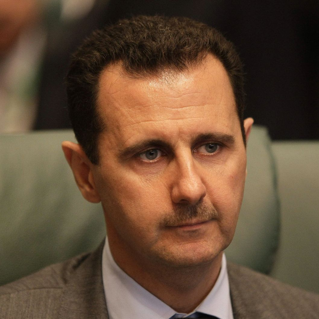 Syrian President Bashar al-Assad attends the closing session of the Arab League Summit in the Libyan coastal city of Sirte on March 28, 2010. Arab leaders met behind closed doors to thrash out a united strategy against Israel's settlement policy as the Jewish state accused them of lacking moderation and blocking peace efforts. AFP PHOTO/JOSEPH EID (Photo credit should read JOSEPH EID/AFP/Getty Images)