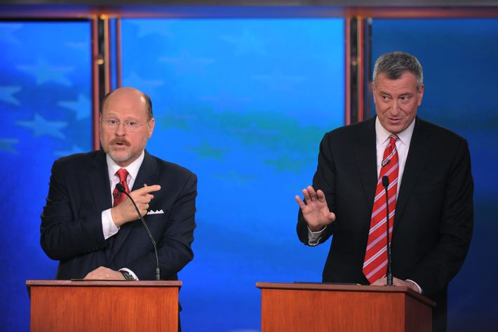 NEW YORK, NY - OCTOBER 30: New York City mayoral candidates (L - R) Joe Lhota (R) and Bill de Blasio (D) participate in a debate on October 30, 2013 in New York City. This is the final debate between the mayoral hopefuls before voters go to the polls November 5.  (Photo by Peter Foley-Pool/Getty Images)