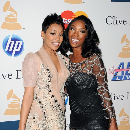 Singers Monica (L) and Brandy arrives at the 2011 Pre-GRAMMY Gala