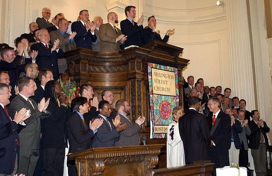 Members of the Boston Gay Men's Chorus applaud as Unitarian reverend Kim Crawford Harvie (in white robe) announces she is able to legally marry David Wilson and Robert Compton (facing each other in front of Rev. Harvie), May 17, 2004, at Arlington Street Church in Boston, Massachusetts. Wilson and Compton joined with twelve other plaintiffs in the court case that legalized gay marriage in Massachusetts. Town halls across Massachusetts were ordered to begin accepting same-sex couples for marriage licenses on May 17.