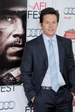 "HOLLYWOOD, CA - NOVEMBER 12: Actor Mark Wahlberg arrives at the AFI FEST 2013 for the ""Lone Survivor"" premiere at TCL Chinese Theatre on November 12, 2013 in Hollywood, California.  (Photo by Gregg DeGuire/WireImage)"
