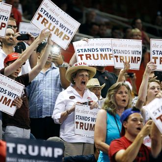 Supporters for Republican presidential candidate Donald Trump cheer as Trump arrives at a campaign rally on June 18, 2016 in Phoenix, Arizona.