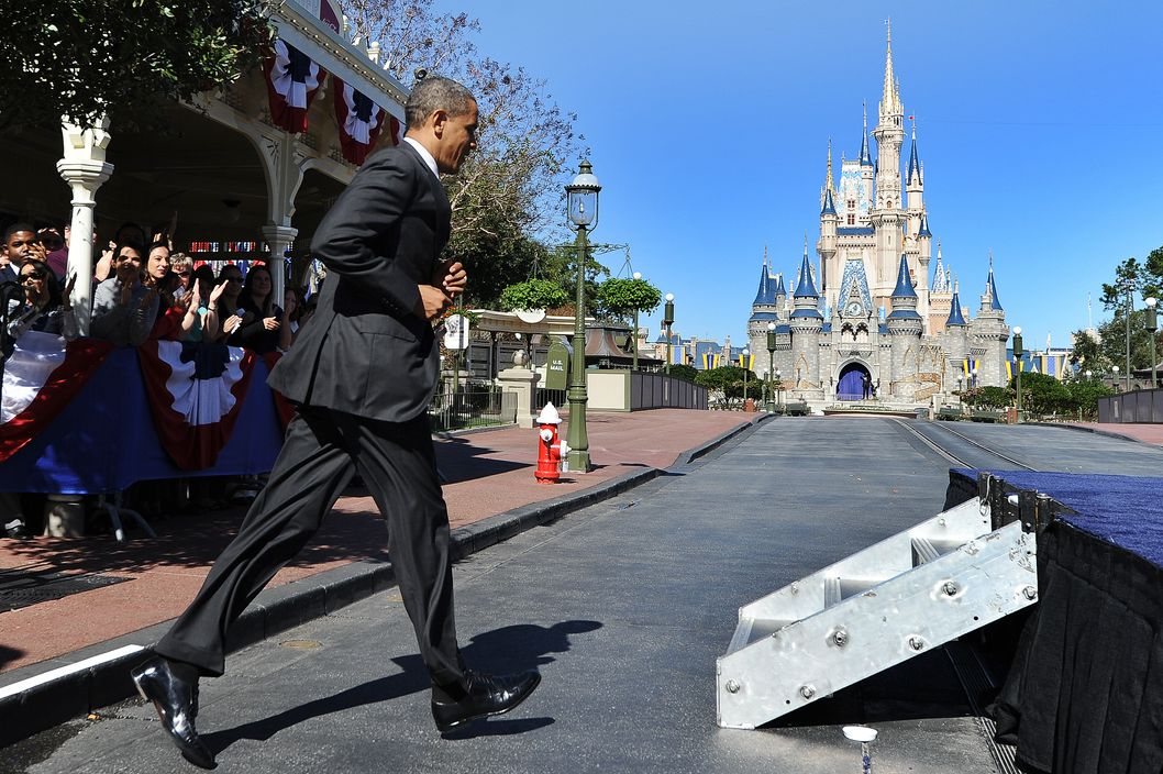 US President Barack Obama jogs to the stage to speak at the Walt Disney World Resort in Lake Buena Vista, Florida, on January 19, 2012 to unveil a strategy that will significantly help boost tourism and travel, an important sector in the US economy.