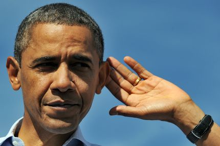 US President Barack Obama gestures as he listens to the public while speaking at the Asheville Regional Airport in Fletcher, North Carolina, on October 17, 2011 during the first day of his three-day American Jobs Act bus tour to discuss jobs and the economy. Obama's tour comes as Republicans and several moderate Democrats remain roadblocks to passing his $447 billion jobs plan in the Senate. AFP Photo/Jewel Samad (Photo credit should read JEWEL SAMAD/AFP/Getty Images)