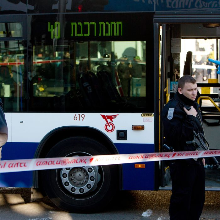 Israeli police officers secure the scene of a stabbing attack in Tel Aviv, Israel, Wednesday, Jan. 21, 2015.