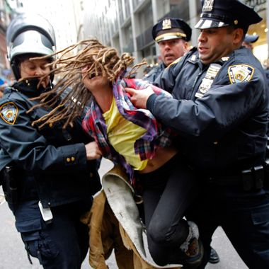 """An Occupy Wall Street demonstrator is arrested by New York City Police during what protest organizers called a """"Day of Action"""" in New York November 17, 2011. Hundreds of Occupy Wall Street protesters marched through New York's financial district toward the stock exchange on Thursday to protest economic inequality at the heart of American capitalism. REUTERS/Mike Segar (UNITED STATES - Tags: BUSINESS CIVIL UNREST)"""