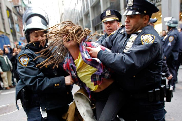 An Occupy Wall Street demonstrator is arrested by New York City Police during what protest organizers called a